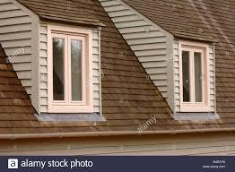 two dormer windows on a timber framed house uk stock photo