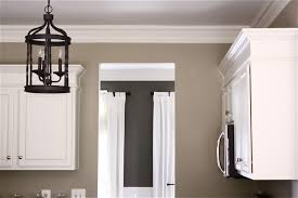 how to add crown molding to kitchen cabinets the yellow cape cod painting kitchen cabinets painted cabinetry