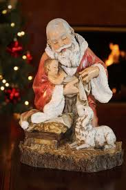 kneeling santa with baby jesus unique tree topper summit arbor