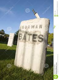halloween knife is stuck in grave of norman bates from the alfred