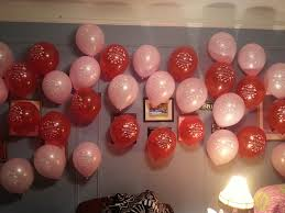 appealing floating ballon wall with pink color close grey wall