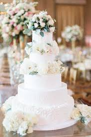 tiered wedding cakes tiered wedding cake with roses elizabeth designs