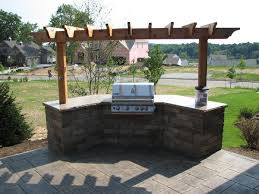 Backyard Brick Patio Design With Grill Station Seating Wall And by Covered Grill Station Not Grill Top But Slide In Like This