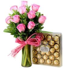 chocolate flowers glass vase arrangement of pink roses n ferrero chocolate flowers