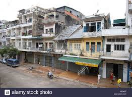 street of houses shops and guest houses in central phnom penh in