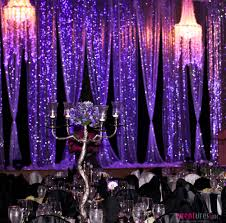 purple sequins and draping chandeliers stage backdrop sequins