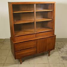 this mid century modern china cabinet is featured in a solid wood