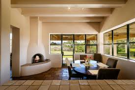 dining room with exposed beam u0026 stone fireplace in santa fe nm