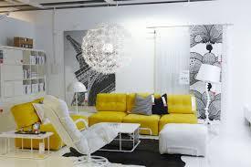 yellow living room living room yellow sofa black concrete wall gray blue rug metal