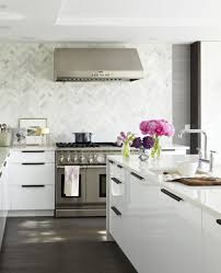 captivating white marble kitchen backsplash with herringbone shape