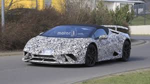 grey lamborghini huracan lamborghini huracan performante spyder spied stripping off camo