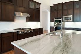 grey granite countertops with brown cabinets grey granite