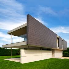 contemporary duplex house design with a plenty of overhang