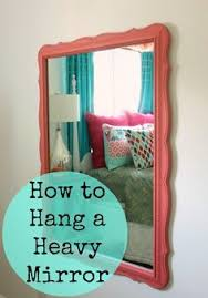 How To Hang A Large Bathroom Mirror - how to hang something heavy like a pro house walls and
