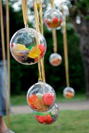 fill clear plastic balls with sweets and treats to make a