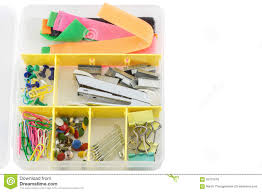 staples and stationery buttons and office equipment in a box stock