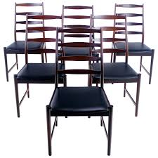 set of six danish modern rosewood ladder back dining chairs by
