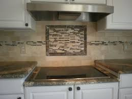 white kitchen cabinet with subway plus light grey mosaic accent