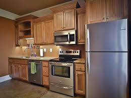 Kitchen With Maple Cabinets Mini Straight Kitchen With Maple Cabinets On Brown Stucco Wall