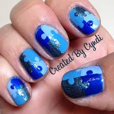 nail art for autism awareness puzzle piece used blue painters