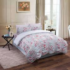 bedroom ruched duvet cover with floral pattern lus rug and table