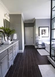 dark hardwood floors grey walls white molding baseboards by