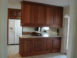wonderful white kitchen island with unpolished mahogany cabinets