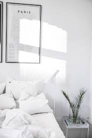 Black And White Bed by A Beautiful Fresh White Bedroom Featuring The Louis Poulsen Aj