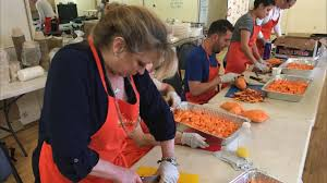 organic soup kitchen volunteers prepare to feed hundreds on