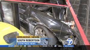 lincoln town car crashes into luxury l a car shop hits ferrari