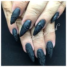 acrylic nails with matte black gel polish and black acrylic 3d