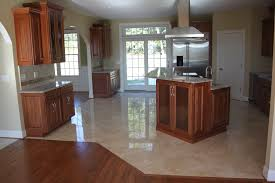 wood flooring ideas for kitchen should your flooring match your kitchen cabinets or countertops