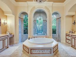 mediterranean master bathroom with round bathtub u0026 rain shower