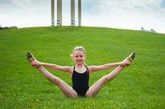 pretee models young beautiful preteen girl doing gymnastics outdoors stock image