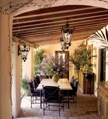 spanish patio with outdoor dining room also traditional lamps also