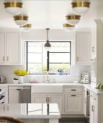 antique white kitchen cabinets brass vancouver interior designer which pulls knobs should you