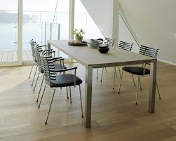 contemporary dining table corian solid wood stainless steel