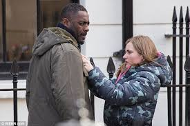 idris elba grapples with co stars as he films action packed scenes