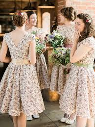rustic wedding at shustoke farm barn with floral bridesmaid dresses