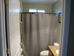 cream wall ceramic tile in shower cabin with white curtain shower