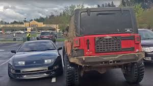 camping jeep wrangler jeep wrangler tries fails to block in badly parked nissan 300zx