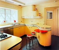 backsplash edge of cabinet or countertop white mid century kitchen hardwood floor white ceramic backsplash