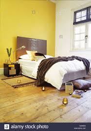 Yellow Feature Wall Bedroom Earthy Under R Large Bedroom Hard Wood Floors In Warm Earth