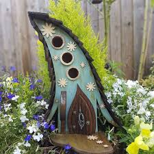 i build fairytale like birdhouses for the tiny creatures that live
