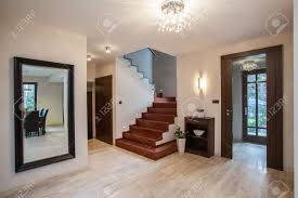 travertine house entrance and hallway modern interior stock