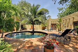 palm tree near pool retaining wall pool eclectic with clay tile