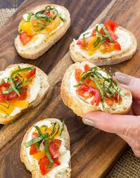 Ina Garten Hors D Oeuvres Crostini With Whipped Feta And Tomatoes Garnish With Lemon