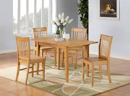Kitchen Table And Chairs With Casters by Wood Cotton Slat Green Solid Oak Kitchen Table And Chair Sets