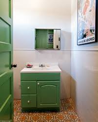 vintage bathroom with artistic floor tiles and vintage bathtub