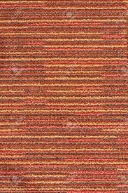red carpet with grunge striped pattern texture background stock